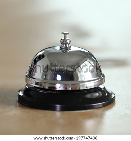 service bell on the hotel reception desk - stock photo