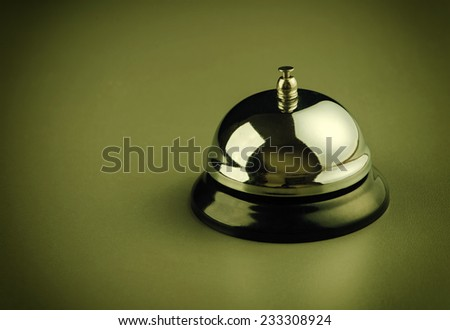 service bell over dark dark yellowish background - stock photo