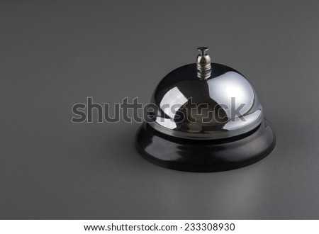 service bell over dark grey background - stock photo