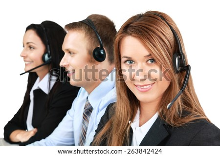 Service. Closeup of a call center employee with headset at workplace - stock photo