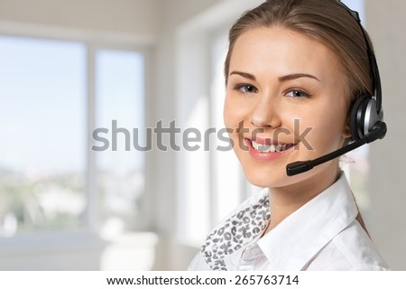 Service. Cute business customer service woman smiling - stock photo