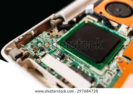 Service of the disassembled laptop. Closeup photo of the processor (cpu) of the netbook - stock photo