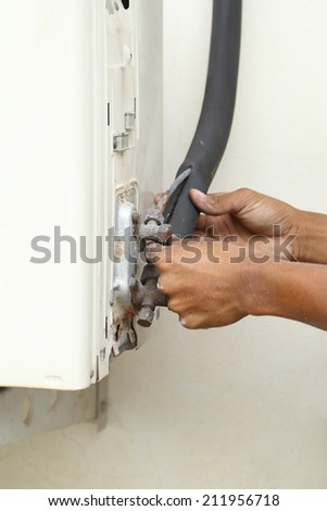 service of the old air conditioner drip valve - stock photo