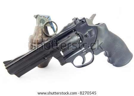 Service revolver and vintage WWII grenade isolated on white - stock photo