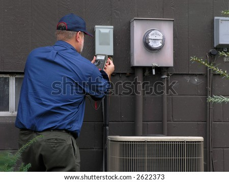 Service technician checks utilities - stock photo