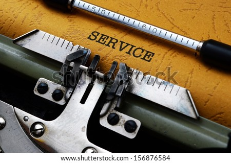 Service text on typewriter - stock photo