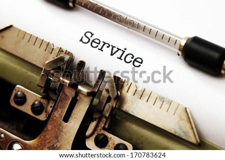Service text on typewriter - stock photo