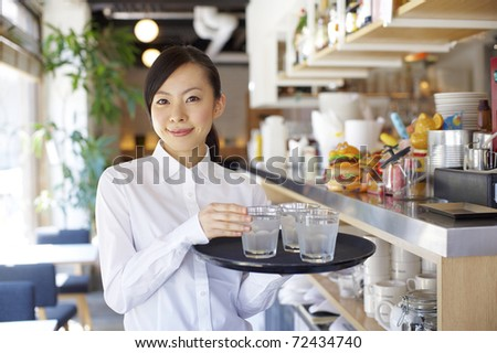 Service woman with a smile - stock photo