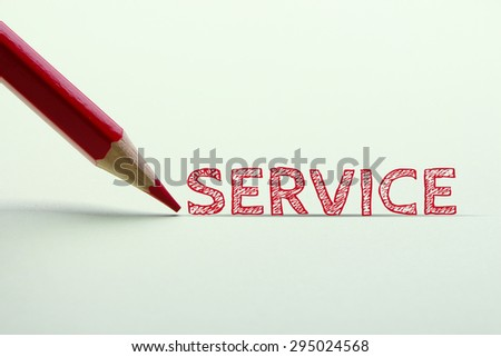 Service word is standing on the paper with red pencil aside. - stock photo