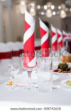 Serving a festive table in restaurant - stock photo