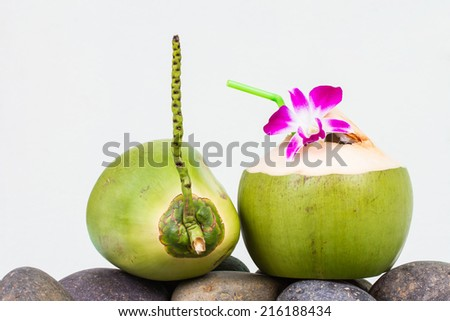 Serving coconut water and decorating orchid flower