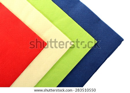 Serving colored paper napkins isolated on white background - stock photo