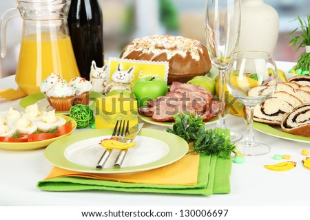 Serving Easter table with tasty dishes close-up