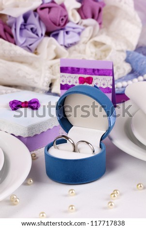 Serving fabulous wedding table in purple color close-up - stock photo
