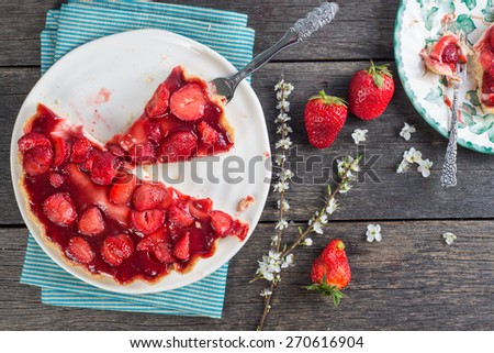 serving homemade strawberry cake or pie on wooden rustic table - stock photo