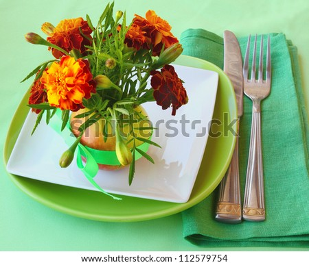Serving of holiday autumn table with marigolds - stock photo