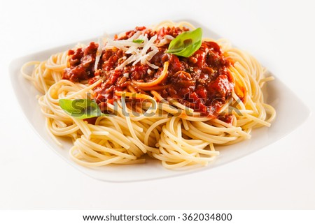 Serving of Italian fettuccine noodles with a ground beef and tomato Bolognaise sauce on a modern square plate isolated on white