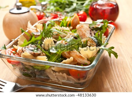 Serving of pasta and chicken salad - stock photo