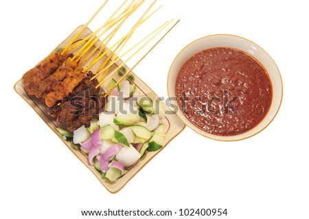 Serving Of Satay With Cucumber,  Onions And Peanut Chili Sauce