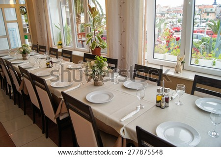 Serving small table with flowers in vases