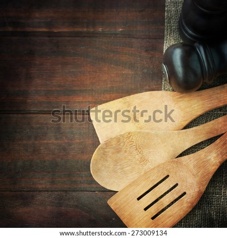 Serving spoons on  wooden surface