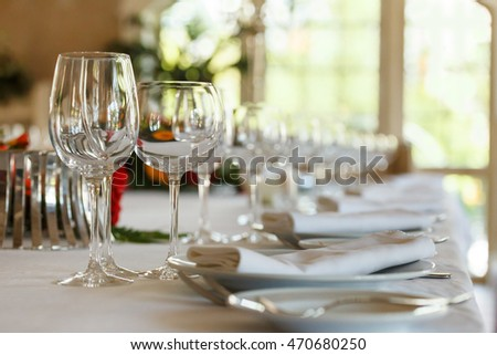 Serving table prepared for event party or wedding. Soft focus, selective focus