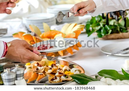 Serving tasteful food, catering - stock photo