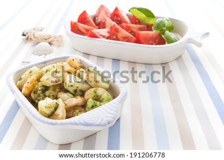 Serving with shrimp and herbs - stock photo