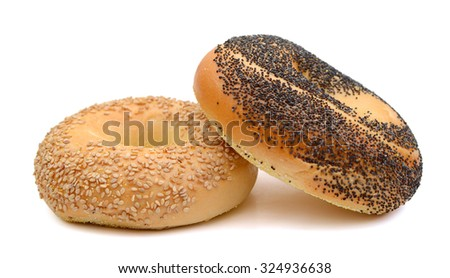 sesame and poppy seed bagels on white background