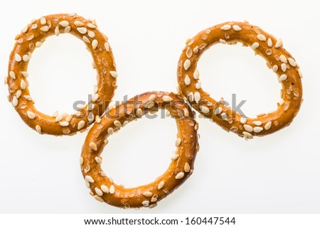 Sesame coated pretzel rings isolated on white