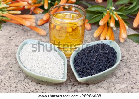 Sesame seed and sesame oil  on a block - stock photo