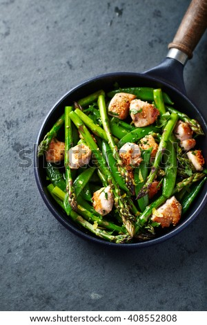 Sesame Seed Chicken with Green Asparagus and Sugar Snap Peas - stock photo