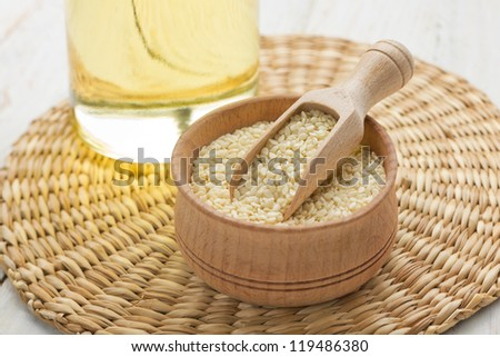 Sesame seeds and oil - stock photo
