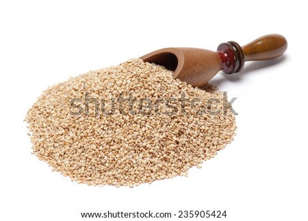 Sesame Seeds and wooden scoop isolated on white background
