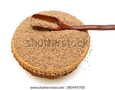 sesame seeds in basket isolated on white background