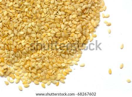 Sesame seeds isolated on white background. - stock photo