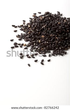 Sesame seeds isolated on white background - stock photo