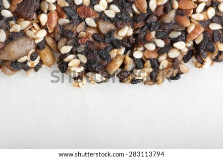 sesame, sunflowers and other seeds with dried fruits , brittle as background - stock photo