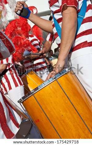 Sesimbra, Portugal - Feb. 2013 - Drummer in the Bateria (musical section) playing for the Samba dancers in the Rio de Janeiro style Carnival. One of the most important Carnivals in Portugal. - stock photo