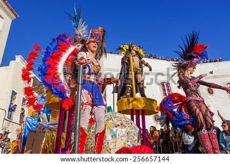 Sesimbra, Portugal. February 17, 2015: Samba dancers performing on top of a Float in the Rio de Janeiro Brazilian style Carnaval Parade. - stock photo
