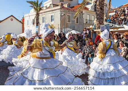 Sesimbra, Portugal. February 17, 2015: The Baianas, one of the most historically important characters of the Rio de Janeiro Brazilian style Carnaval Parade, dancing Samba. Represented by older women. - stock photo