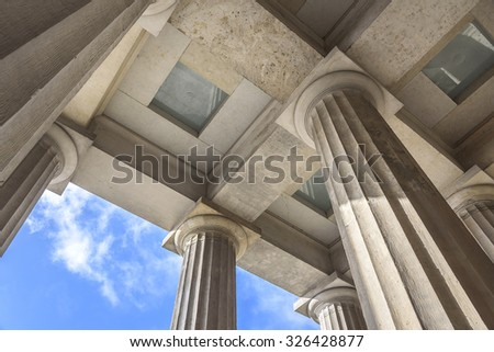 Set above the columns of the old palace in detail.
