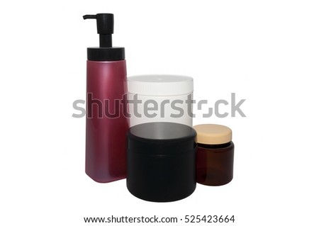 set and plastic cans of a different form and color on a white background