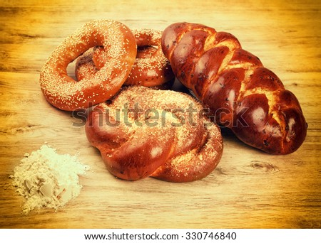 set bread on wooden table - stock photo