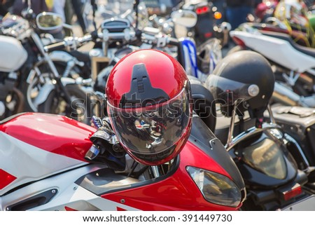 set bright motorcycles on parking in afternoon - stock photo