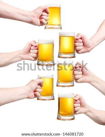 Set, closeup of a male hand holding up a glass of beer over a white background - stock photo