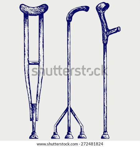 Set crutches. Doodle style. Raster version - stock photo