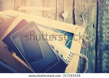 Set for Business Men with Black and Beige Accessories and Digital Gadgets  on Home Wooden Table. Tablet pc, phone, paper, different stuff in stack. Top view, toned - stock photo