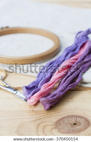 Set for embroidery, embroidery hoop and embroidery thread, selective focus - stock photo