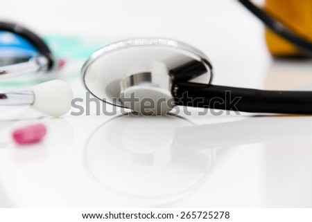 Set for flu treatment -  pills, thermometer, nasal sprays, protective surgical mask, stethoscope, syringe... - stock photo
